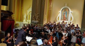 Charles Cole, choir, and orchestra rehearsing for the Requiem
